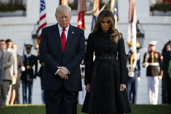 President Donald Trump and first lady Melania Trump stand for a moment of silence to mark the anniversary of the Sept. 11 terrorist attacks, on the South Lawn of the White House, Monday, Sept. 11, 2017, in Washington. (Evan Vucci/AP)
