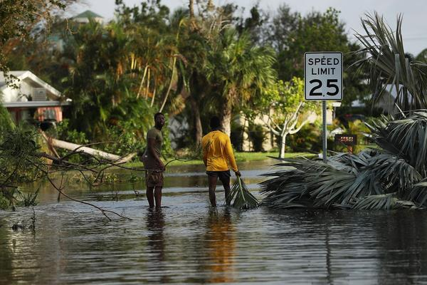 People walk through flooded streets the morning after Hurricane Irma swept through the area on Sept. 11, 2017 in Fort Myers, Fla. (Spencer Platt/Getty Images)