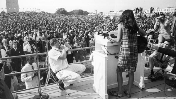 "Joan Baez performing at the the Civil Rights March on Washington in 1963. She sang ""We Shall Overcome"" and ""Oh Freedom."""