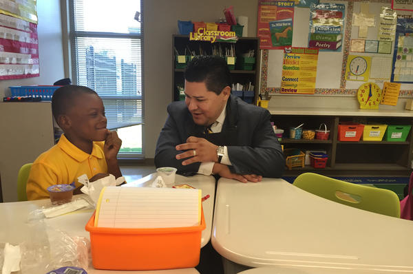 Superintendent Richard Carranza served breakfast to second-graders on the first day of school.  The district is providing three free meals a day to all its 215,000 students this year because of Harvey.