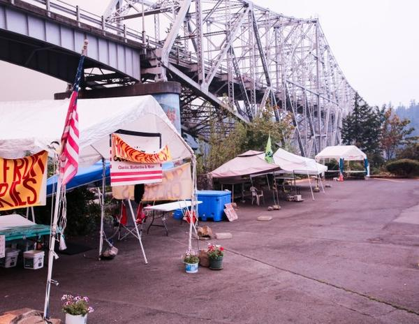 <p>Beneath the Bridge of the Gods, the Cascade Locks farmer's market sits empty on Monday, Sept. 4, 2017, as the Eagle Creek Fire threatens the community.</p>