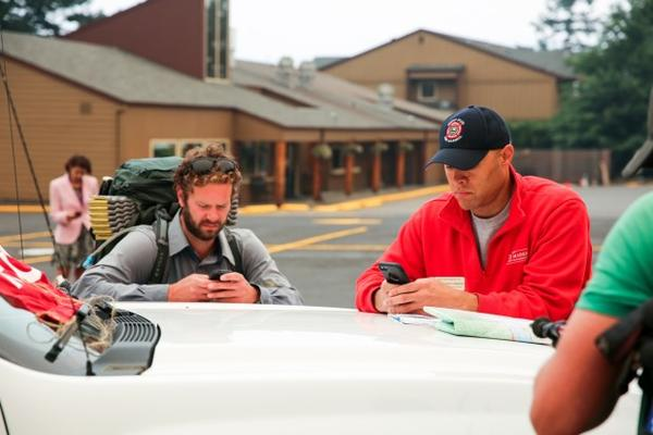 <p>Ben Connelly, left, is hiking the Pacific Crest Trail. PCT. Interrupted by the Eagle Creek Fire, he says fires in Oregon have prevented him from hiking about half the state.</p>