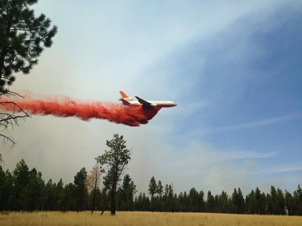 <p>A heavy air tanker flies over the Milli Fire in the Three Sisters Wilderness in Central Oregon.</p>