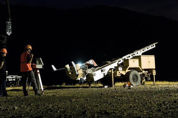 The roughly 45-pound ScanEagle reconnaissance drone rests on its catapult launcher on the banks of the Columbia River in Bingen shortly before launch on Sunday.