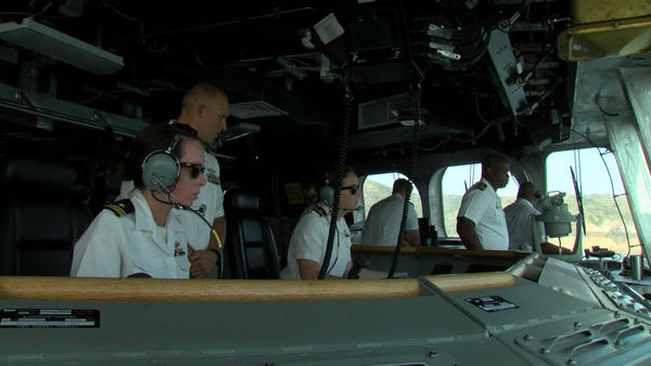 Sailors steer the USS Gabrielle Giffords as the ship comes into San Diego.