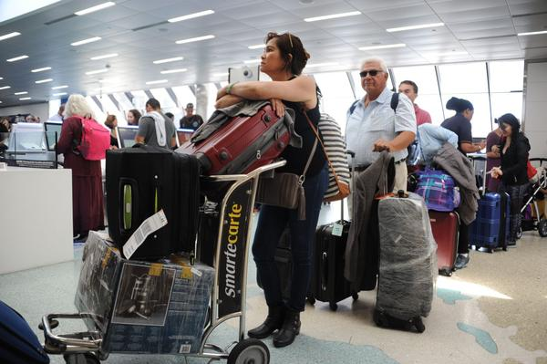 People crowd Fort Lauderdale International Airport as evacuation is underway for the arrival of Hurricane Irma, Sept. 7, 2017 in Fort Lauderdale, Fla. (Michele Eve Sandberg/AFP/Getty Images)