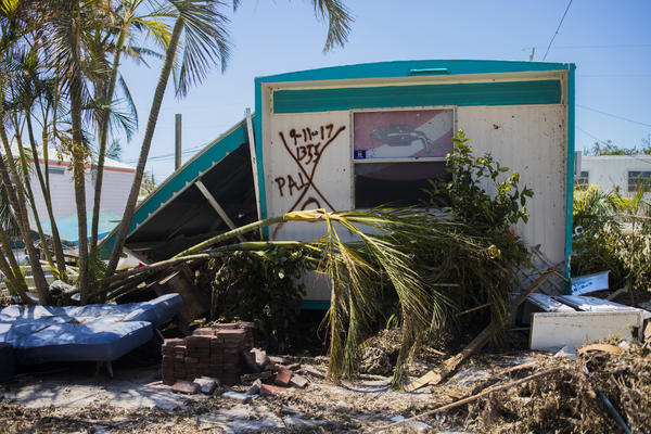 The homes still standing in Sea Breeze Mobile Home Community had been marked by search and rescue crews.