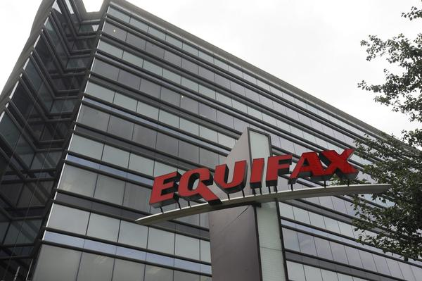 Credit monitoring company Equifax says a breach exposed social security numbers and other data from about 143 million Americans. (Mike Stewart/AP)
