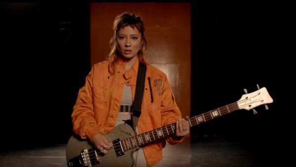 """A still from Chela's """"Bad Habit"""" video."""