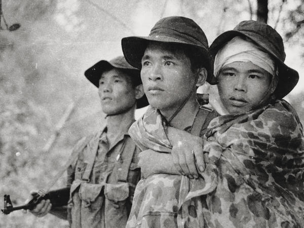 Burns explores the Vietnam War from multiple perspectives in his new documentary. Here, a Viet Cong guerrilla fighter carries a wounded friend during action along the Cambodian border.