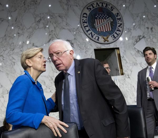 Sen. Elizabeth Warren, D-Mass. speaks with Sen. Bernie Sanders, I-Vt. at the Senate Health, Education, Labor, and Pensions Committee hearing with governors to discuses ways to stabilize health insurance markets, on Capitol Hill in Washington on Sept. 7. (Jose Luis Magana/AP)