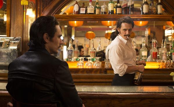 "This image released by HBO shows James Franco portraying twins Vincent and Frankie Martino in, ""The Deuce,"" a new HBO series about Times Square in the early 1970s. (HBO via AP)"