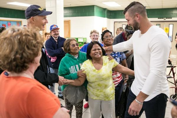 Former University of Florida Football Player Tim Tebow joins Governor Rick Scott at a Jacksonville Shelter.