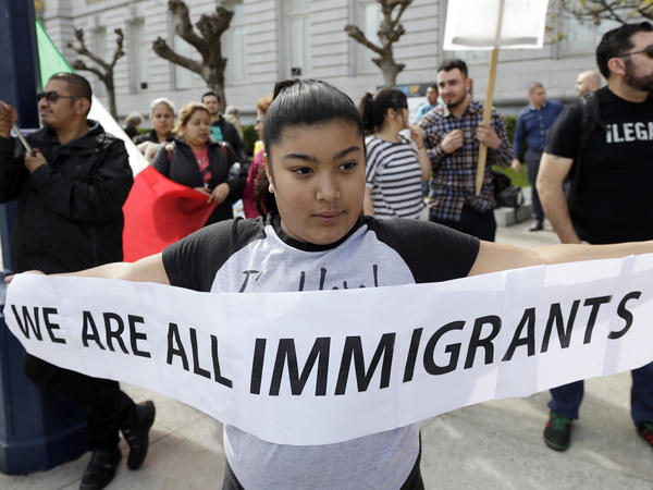 Delilah Gutierrez holds a sign during a protest against President Trump's efforts to crack down on immigration in San Francisco earlier this year.