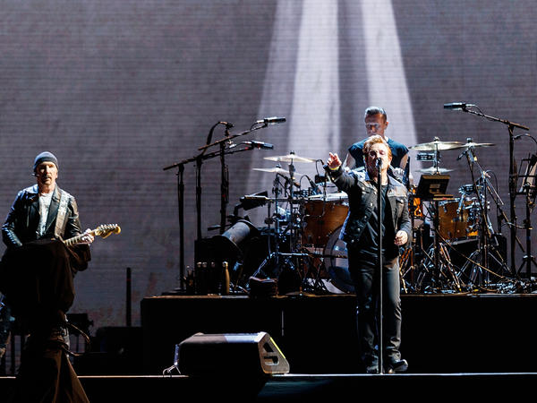 The Edge (from left), Bono and Larry Mullen Jr. of rock band U2 will not be bringing their The Joshua Tree World Tour to St. Louis this weekend amid security concerns.