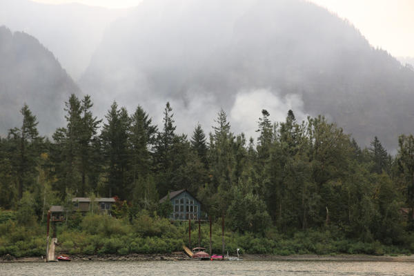 <p>Waterside homes in the small town of Dodson sit in lush green forest. But the Eagle Creek Fire is not far away.</p>