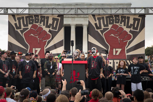 Violent J (left, center) and Shaggy 2 Dope (right) of Insane Clown Posse address the crowd at the Lincoln Memorial in Washington, D.C., at Saturday's Juggalo March.