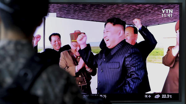 A South Korean soldier watches a TV local news program Saturday depicting North Korean leader Kim Jong Un.