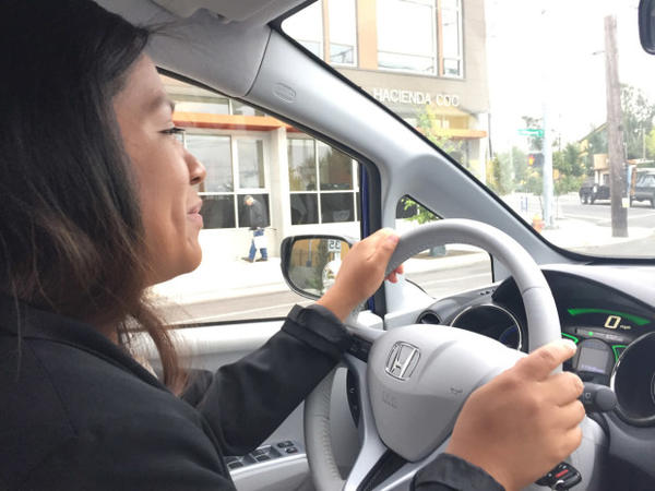 <p>Ana Mendoza drives to a panel discussion in a shared electric car based at the Hacienda low-income housing community.</p>