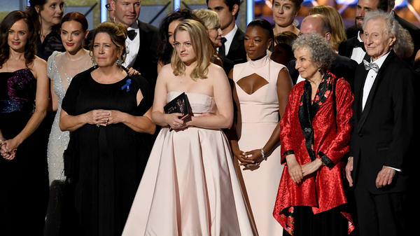 The cast and crew of <em>The Handmaid's</em> <em>Tale — </em>including Emmy winners Ann Dowd and Elisabeth Moss, actress Samira Wiley, and author Margaret Atwood — onstage during the 69th Primetime Emmy Awards.