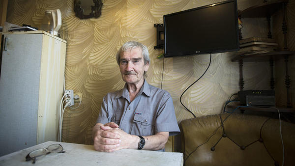 Stanislav Petrov, a former Soviet military officer, poses at his home in 2015 near Moscow. In 1983, he was on duty when the Soviet Union's early warning satellite indicated the U.S. had fired nuclear weapons at his country. He suspected, correctly, it was a false alarm and did not immediately send the report up the chain of command. Petrov died at age 77.