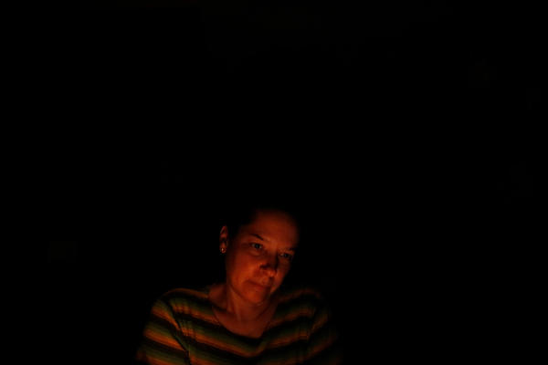Nancy sits in the kitchen lit by one candle deciding whether to try and make food in the dark, or just go to bed.