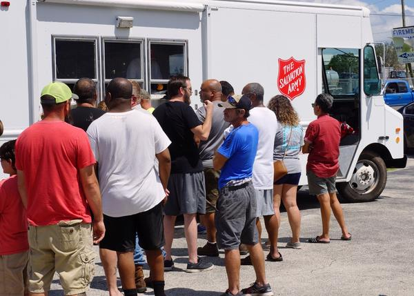 A line of Highlands County residents waiting for a hot meal and cold bottle of water from one of 61 Salvation Army mobile feeding units operating in Florida after Hurricane Irma.