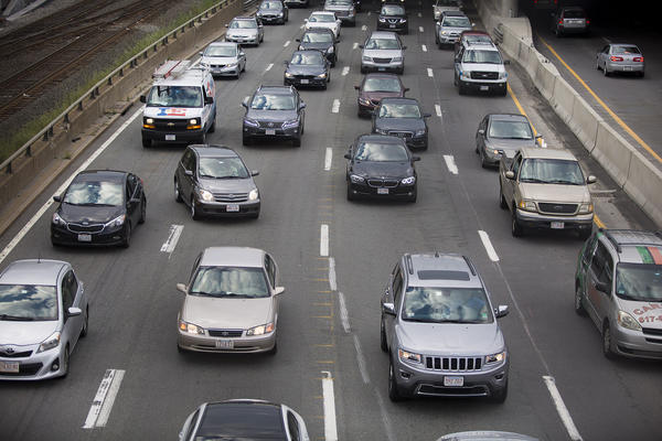 Cars crawl at a snail's pace on the Mass Pike during the Friday evening commute. (Jesse Costa/WBUR)