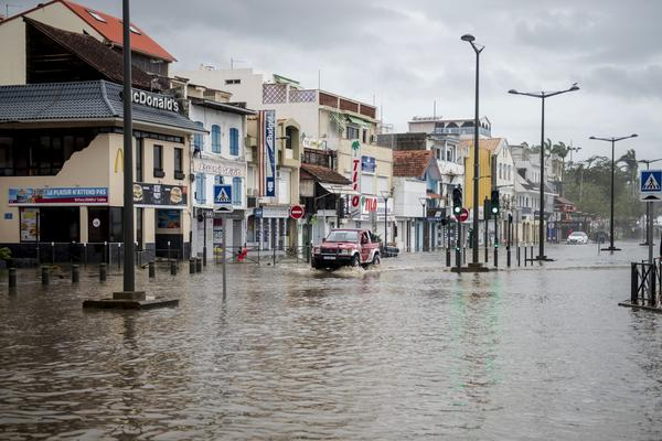 A motorist drives on the flooded waterfront in Fort-de-France, on the French Caribbean island of Martinique, after it was hit by Hurricane Maria, on Sept. 19, 2017. Martinique, suffered power outages but avoided major damage. (Lionel Chamoiseau/AFP/Getty Images)