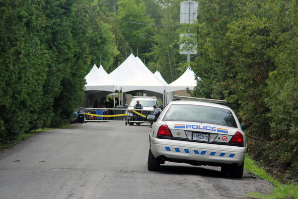 Canadian police have set up a tent to process all the asylum-seekers crossing illegally on this rural road connecting Champlain, New York to Hemmingford, Quebec.