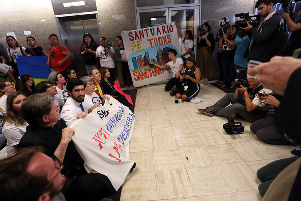 """Austin City Council Member Greg Casar joined a protest at the Texas State Insurance Building to protest Senate Bill 4, which would regulate so-called """"sanctuary"""" jurisdictions."""