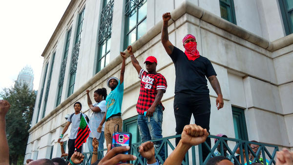 The police shooting of Keith Scott a year ago sparked protests that led to the creation of Charlotte Uprising. These protesters stood on a wall outside CMPD headquarters on Sept. 21, 2016.