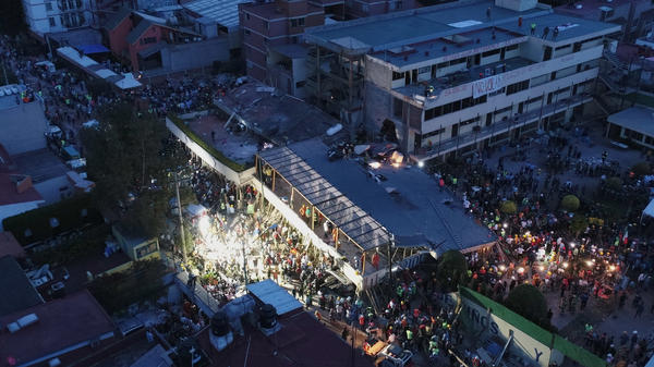 Mexican rescue teams work in the early hours Wednesday, searching for people trapped in the rubble at the Enrique Rebsamen elementary school in Mexico City.