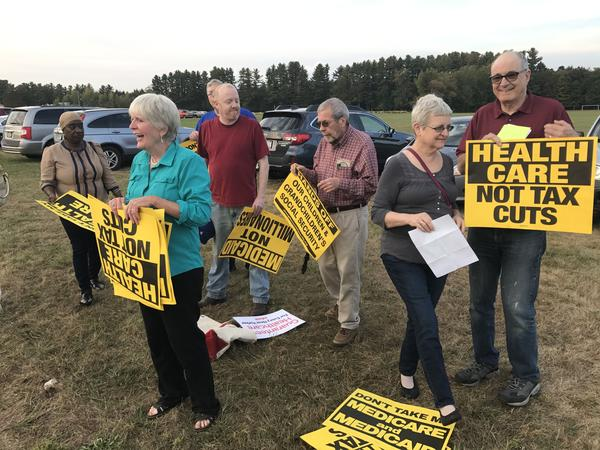Opponents of a Senate bill that would repeal and replace the Affordable Care Act rally outside of a town hall event in Oneida County.