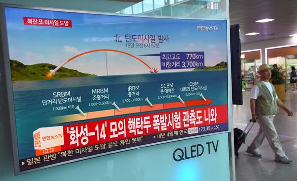 A screen at a railway station in Seoul on Friday shows a news graphic of a North Korean missile launch. President Trump said on Thursday there would be additional sanctions on North Korea.