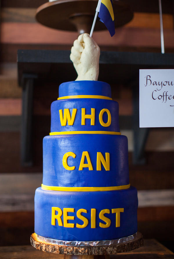 "This defiant creation, by Tressa Wiles of Bayou Bakery, features a fist gripping one of the Human Rights Campaign's ""equality flags."""