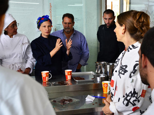 Di Giacobbe and Chloe Doutre, an international chocolate expert, give a class at Cacao de Origen on the secrets of processing quality chocolate. In the audience are women entrepreneurs and CDO staff.