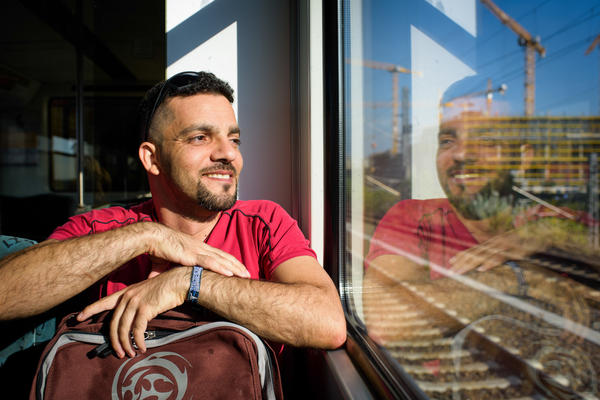 Aktham Abulhusn rides the subway on his way to Berlin Alexanderplatz. He came from Syria to Germany in early 2015 on a student visa and now lives there on a refugee visa. Now that his German language skills are improving, he is trying to find a girlfriend.