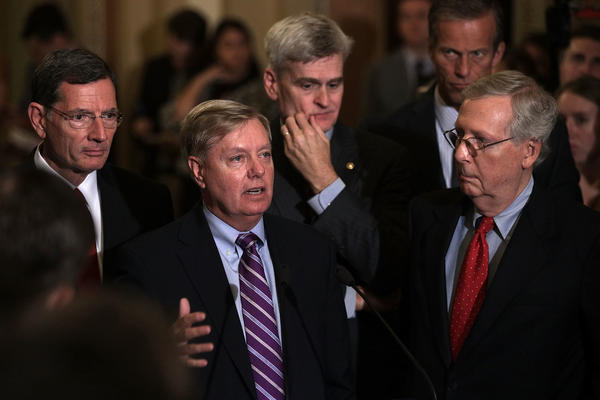 Sen. Lindsey Graham, second from left, speaks as Sen. John Barrasso, from left, Sen. Bill Cassidy, Sen. John Thune and Senate Majority Leader Sen. Mitch McConnell listen during a news briefing Tuesday.