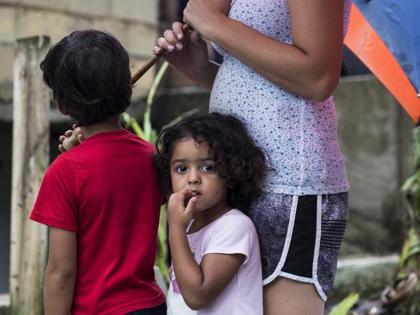 Three-year-old Deyanery Ramirez is in the La Perla neighborhood of San Juan, Puerto Rico, on Thursday. Without cell service on the island, it has been difficult for people to check on their loved ones.