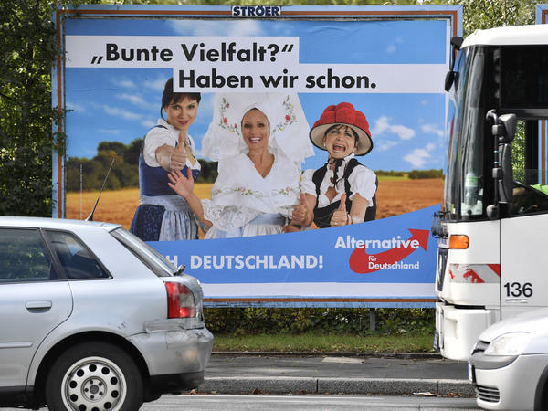 "A poster in Essen showing women in traditional German dress promotes the far-right party Alternative for Germany. The poster says, ""Colorful variety? We have already."""