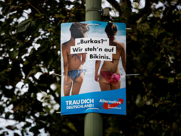 "A poster from the far-right Alternative for Germany in Berlin reads ""Burkas? We prefer bikinis."""