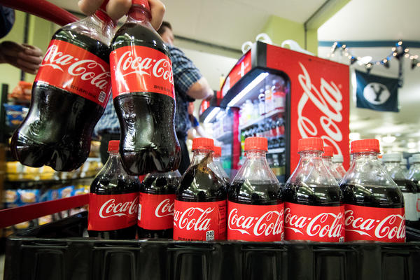 Employees from dining services stock bottles of Coca-Cola and other caffeinated sodas in the Cougareat at the Wilkinson Student Center on BYU's Campus. This marks the first time caffeinated sodas have been available at campus eateries since the mid 1950's.