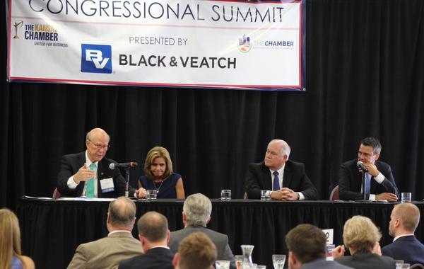 Sen. Pat Roberts speaks a Friday's congressional summit, as Reps. Lynn Jenkins, Ron Estes and Kevin Yoder look on.