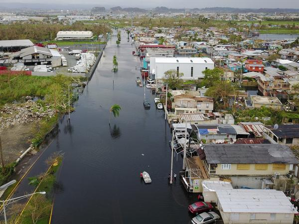 An aerial view shows the flooded neighborhood of Juana Matos in the aftermath of Hurricane Maria in Catano, Puerto Rico, on Friday. The island could be without power for months, complicating relief efforts.