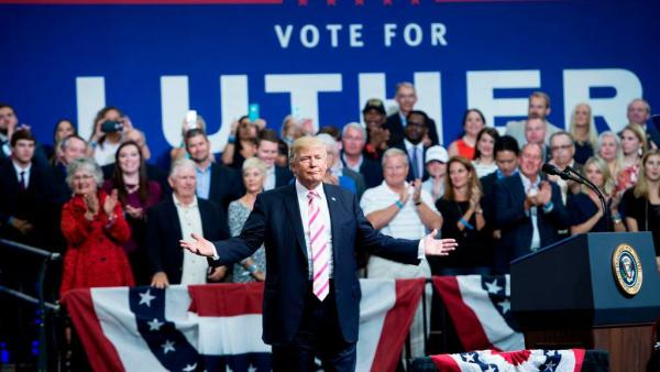 President Trump gestures while speaking during rally for Sen. Luther Strange, R-Ala., in Huntsville, Ala., on Friday.