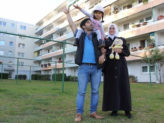 Mohammed Eh'tai fled Syria a couple of years ago. He has been reunited with wife Rawah, holding a doll that is one of the only items from their old life in Syria, and their daughter Rimas.
