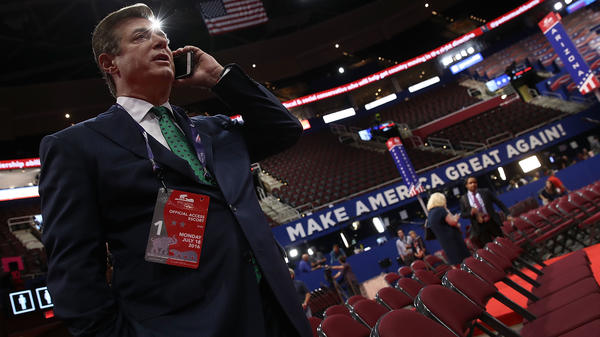 Paul Manafort speaks on the phone while touring the floor of the Republican National Convention on July 17, 2016, in Cleveland, Ohio.
