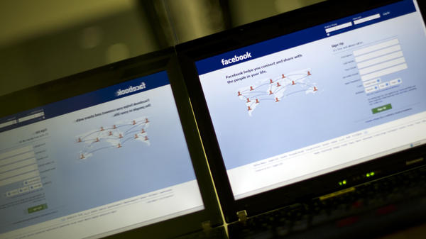 In a file photo taken on May 15, 2012, a login page of Facebook reflects in a glass panel in Kuala Lumpur.
