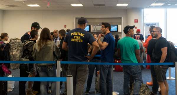 First responders and travelers wait in line at Miami International Airport to be rebooked after their 7:20 a.m. Saturday flight to Puerto Rico was canceled. Many are trying to reach those affected by the destructive path of Hurricane Maria.